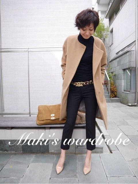 Camel coat, large warm gold leather bag, black top and cropped pant with nude shoes and chunky gold buckle on leopard print belt.