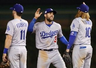 Logan Forsythe, Chris Taylor, and Justin Turner of the Los Angeles Dodgers celebrate after beating the Chicago Cubs 6-1 during Game 3 of the National League Championship Series at Wrigley Field on October 17, 2017 in Chicago, Illinois. (Jonathan Daniel | Getty Images)