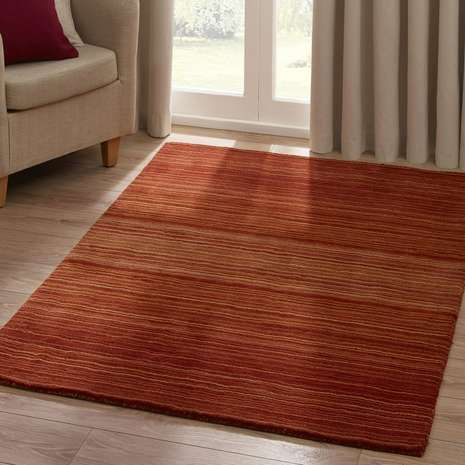 Hand tufted from 100% wool with a range of colours to choose from, this striped rug will add warmth to your flooring, available in a choice of sizes to fit.
