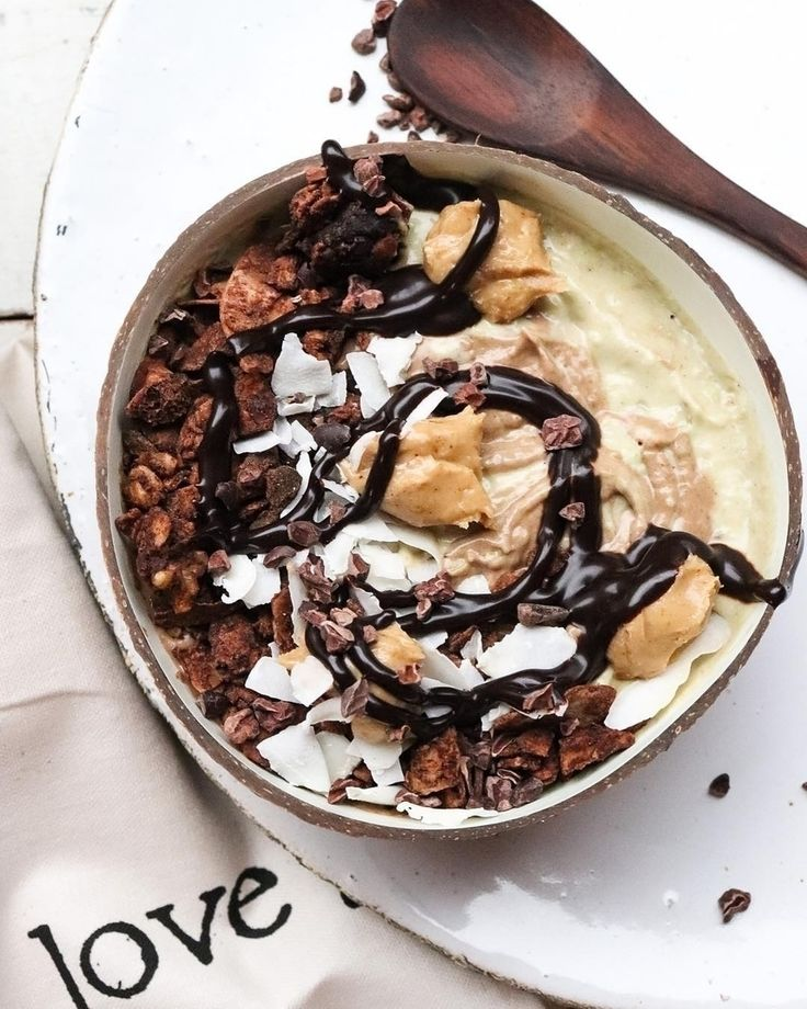 "We just don't know how much more deliciousness you could pack into a coco bowl @cleansupperclub_ ""Delicious nice cream blend of frozen bananas, coconut yoghurt, avocado & peanut butter. For half and then the other half added cacao. Cacao granola, coconut flakes, choc shot & more smooth peanut butter.""    This is our white coconut bowl! It features a food-safe white lacquer coated inner shell - Get yours at www.coconutbowls.com!"