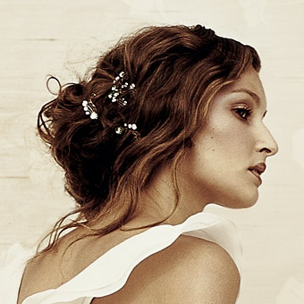 If you're in your mid 30's/40's and want a romantic/grecian look try a loose updo instead of hair down and just add a few deco pins to the back rather than big hair accessories or tiaras. It's much more sophisticated but still very pretty.