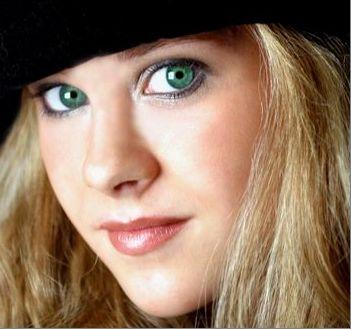 strawberry blonde hair green eyes