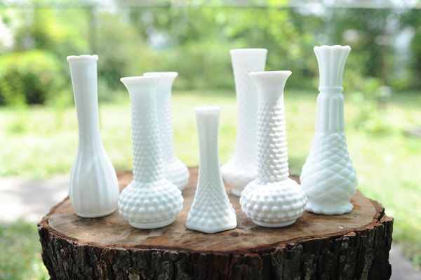 Break up the formal memorial flower arrangements, and put them instead in vintage milk glass bud vases (like these)