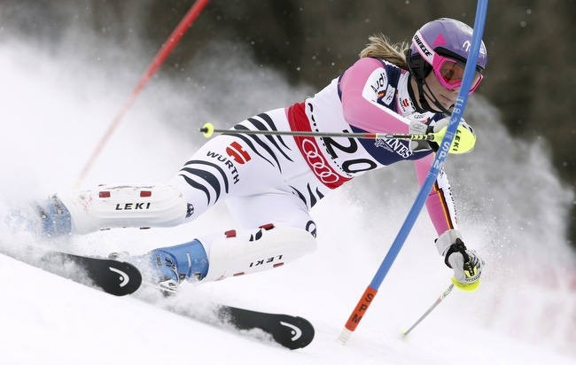 Germany's Maria Hoefl-Riesch speeds down the course during the slalom portion of the women's super-combined, at the Alpine skiing world championships in Schladming, Austria, Friday, Feb.8, 2013. (AP Photo/Alessandro Trovati)