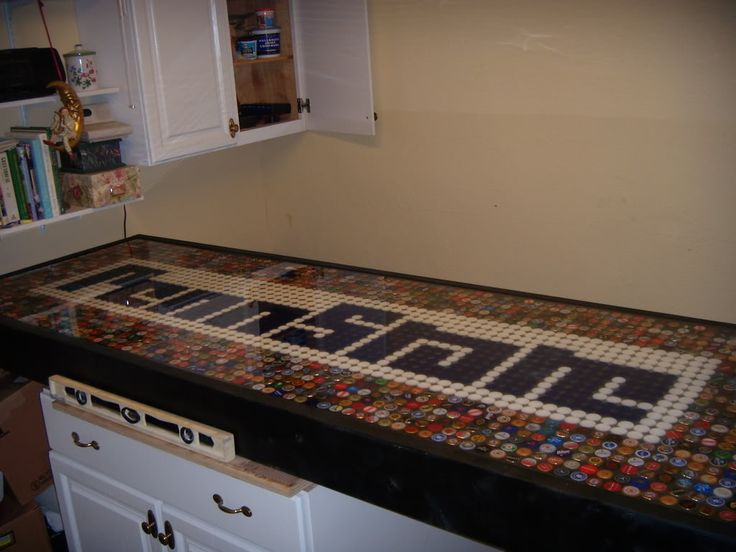 Bottle Cap Table Top - This is the first useful site I found that will completely seal the caps to the top.