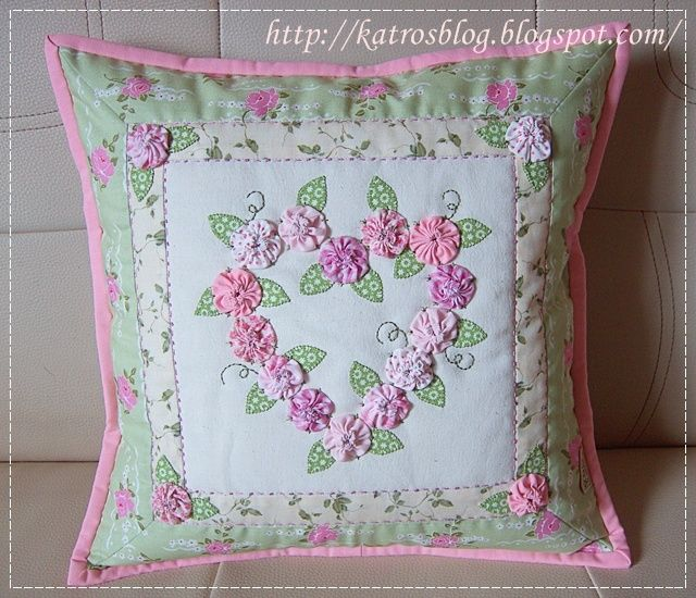 Nice idea for pillow or cushion case. Make yoyos from fabric scraps.