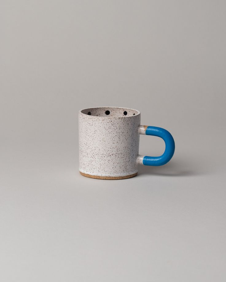 Ceramic mug with rubber dipped handle Recreation Center is a small, Brooklyn, New York based brand, focused on functional ceramic pieces inspired by print and sculpture