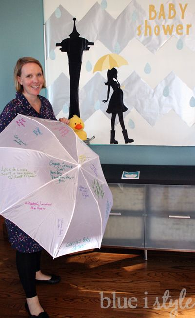 Use pastel colored sharpies to turn a white umbrella in to a guest book for a rain shower themed baby shower {blue i style}