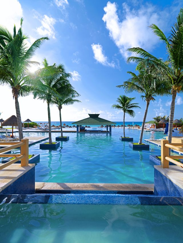 Iberostar Cancun - one of my favorites in Cancun.  Family all inclusive with a fantastic beach and endless pool area!