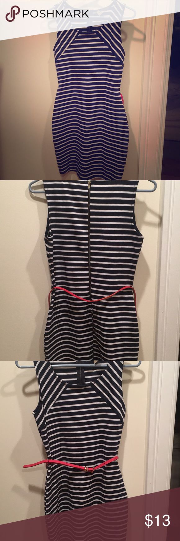 Navy and white striped dress size M Navy and white striped short dress with a thin red belt. I LOVED this dress while it fit, now it's time to let someone else rock it. I wore it a handful of time, but it's in good condition! enRoute Dresses Mini