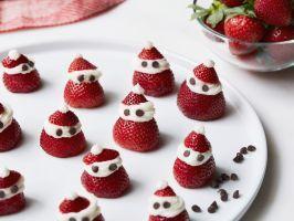 Strawberry Santas : These delicate holiday treats are great for brunch or as a light dessert. For assembly, Giada pipes rich mascarpone frosting onto cut strawberries, reserving the strawberry tip for Santa's hat.