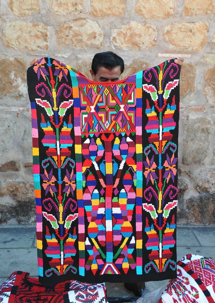 A man from Usila in northern Oaxaca. Mexico, displays a beautiful huipil from Valle Nacional (Chinantec). Karen Elwell via flickr.