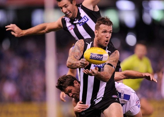 Dane Swan and Darren Jolly at Docklands Stadium, vs North Melbourne, 31 Mar 2013. Pies win 103 - 87.