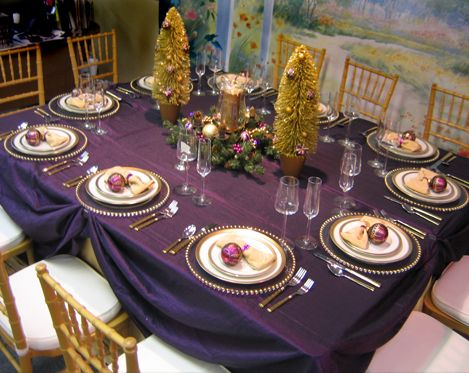 Swaged Plum Satin Tablecloths Are The Star Of This Tablescape