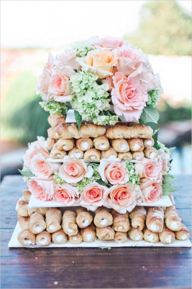 Pile cannoli into a tiered cake as an alternative wedding cake option.