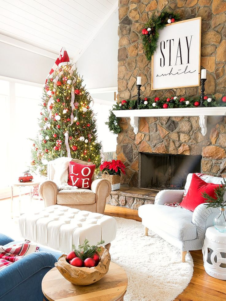 Love this beautiful mantel with fun wood sign for Christmas