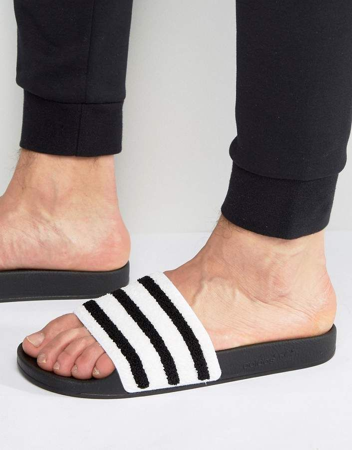 be464b477b09ca Check out these Adidas Originals Adilette Slides In Black Toweling from  ASOS. The straps act as a natural moisture absorbing towel helping to keep  your feet ...