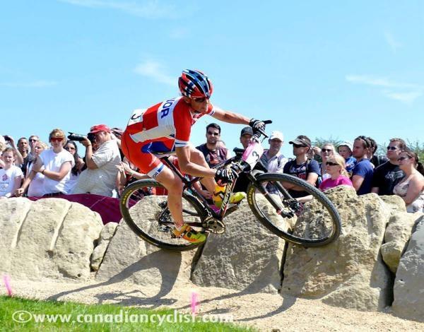 Gunn-Rita Dahle Flesjaa (Norway) carves a great turn in the 2012 Olympic cross-country mtn bike race.