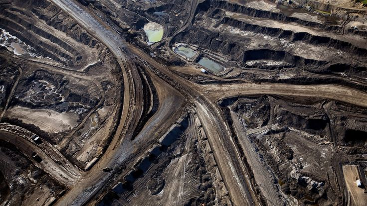 Alberta will cap oil-sands emissions for producers such as Suncor Energy Inc. and Imperial Oil Ltd., phase out coal power plants and implement an economy-wide price for carbon in an effort to curb pollution from Canada's largest greenhouse-gas emitter.