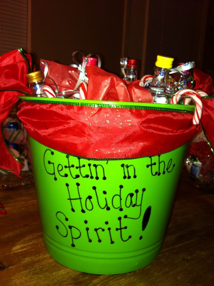 A white elephant gift I put together was such a fun idea & a hit at the party! Dollar store bucket, tissue paper & candy canes. Hand painted beer steins filled w travel size liquor.