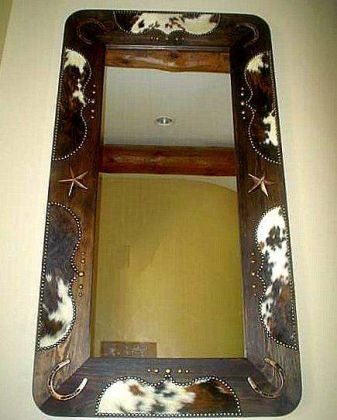 """Here is another of my original DESIGNS! This is a COMPLETELY """"hand crafted"""" and UNIQUE wood entryway mirror, that has been """"fancied-up"""" with various sizes of """"Clavos"""" and cast iron stars & Horseshoes! The wood is stained Dark Walnut, and shown here covered in: Tri Color hide with Bronze Renaissance tacking. This is available in: Read more..."""