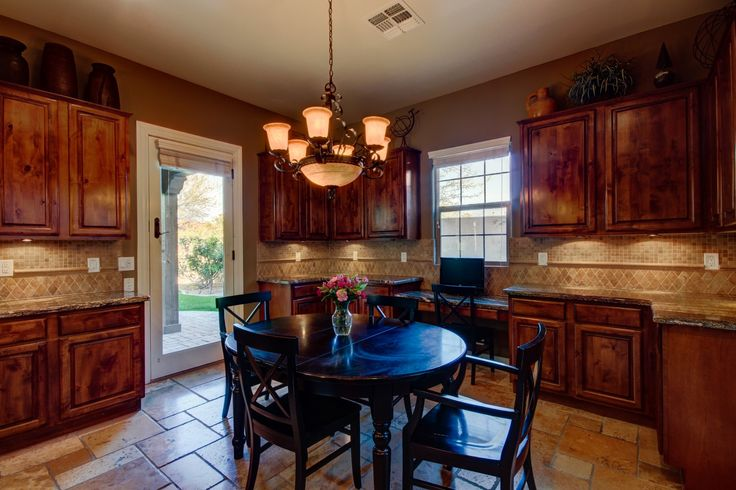 Dining room, chandelier, tile, cabinets, dark wood, backsplash