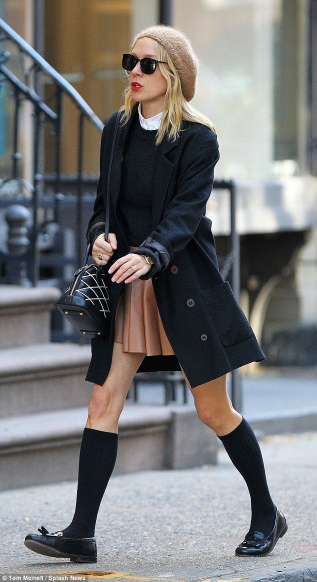 Style star: The 39-year-old worked a Parisian-inspired look with a beret, navy overcoat, k...