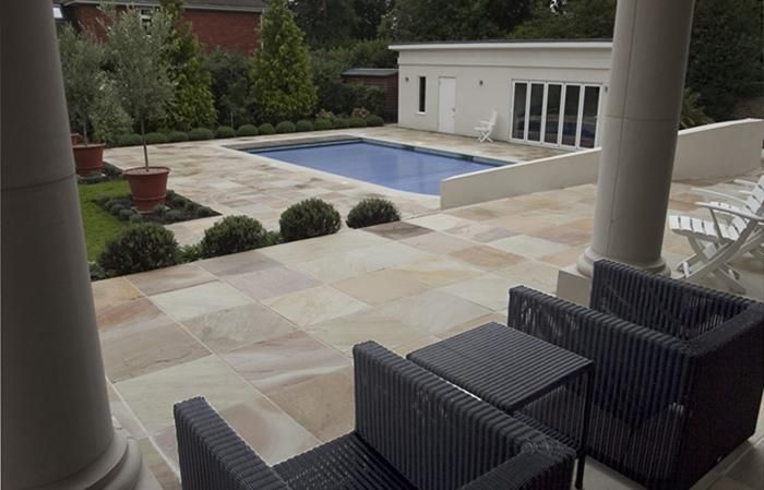Mint sandstone will brighten up any area. It can be laid in random sizes or in single sizes like in the image. On this project the stone has been used for paving, steps and pool copings