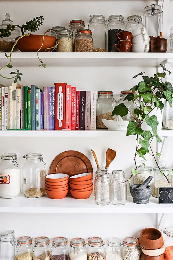 Inspiring Spaces- Kitchens! via A House in the Hills - love the mix of grain storage and cookbooks.