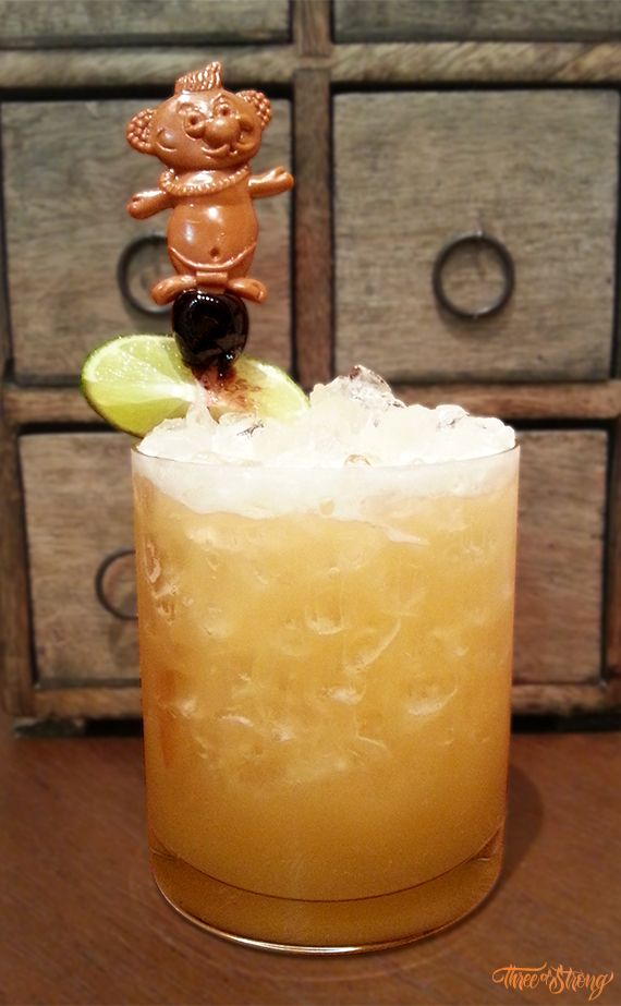 ★★★☆☆ - Trader Vic's Grog - 1 oz Lemon Juice - 1 oz Pineapple Juice - 1 oz Passion Fruit Syrup - 2 oz Dark Jamaican Rum - 1 dash Angostura Bitters - Shake with crushed ice and pour into a tulip glass. Garnish with mint sprigs.
