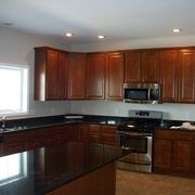 Kitchen with Seneca Ridge cherry paprika cabinets, granite countertops by Rochester Homes | www.rochesterhomesinc.com