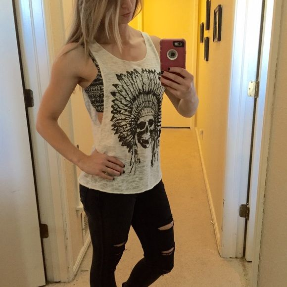 Native American skull tank top black and white Med Medium sized tank top. Graphic features Native American skull in a headdress. This shirt is somewhat see through so a bandeu or cami is necessary. Material is very soft. Poetry Tops Tank Tops
