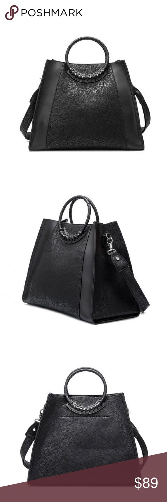 "Melie Bianco Louise Woven Handle shoulder bag This beauty is for the independent women. Stylish and casual chic. Premium vegan leather. Middle top zipper . Interior slim pockets and interior zipper pocket. 14""Lx 4.5W x 12H. In black #meliebianco Melie Bianco Bags Shoulder Bags"
