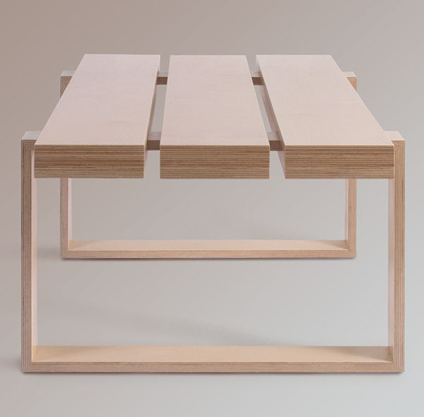 The design plays with the laminations of the plywood. The mitred joints in the legs create a seamless band which passes through the top sections ...