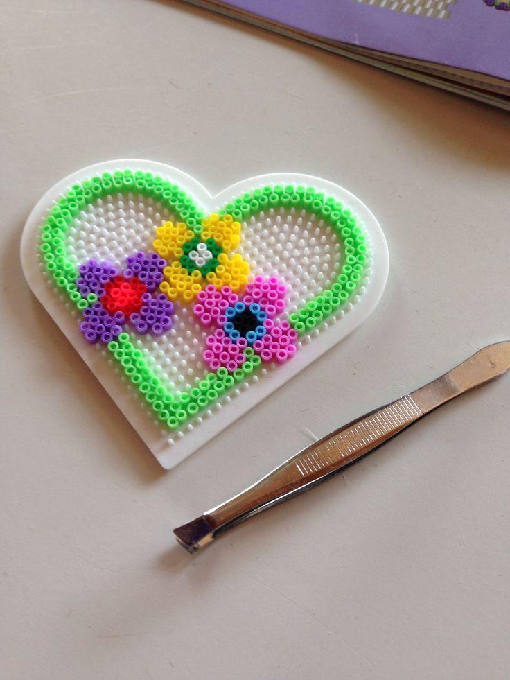 Heart and flowers hama mini beads by Tina Olsen