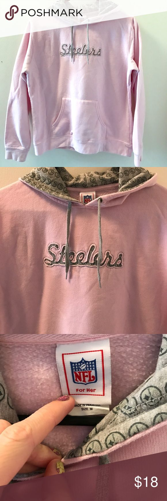 Pink Female Steelers Hoodie Pink Steelers Hoodie! Steeler emblem detail in the letters on the front and in the hood. Size M. Worn very few times. Slight darkened area on the back (as pictured) but no damages. NFL Tops Sweatshirts & Hoodies