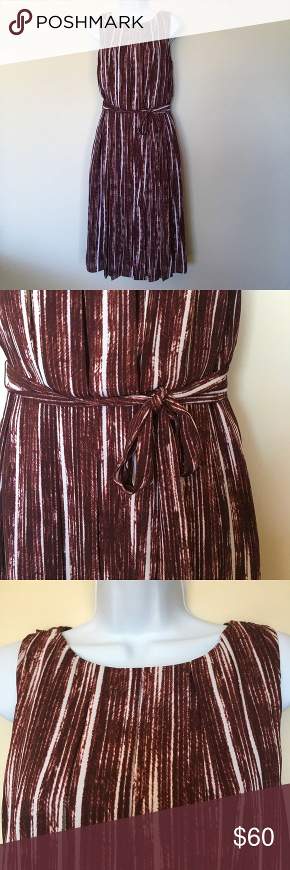 "Banana Republic dress NWOT Cute deep wine color and white with a belted tie.  Soft pleats on bodice and skirt.  Back zipper from tail bone to neck.  Hem length is 27.25"" from waist.  Never worn. Banana Republic Dresses Midi"