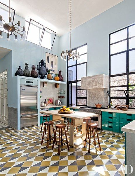 Unique floor tiles punch up the kitchen, which includes cabinetry by Bohl Architects and a refrigerator and range by Viking   archdigest.com