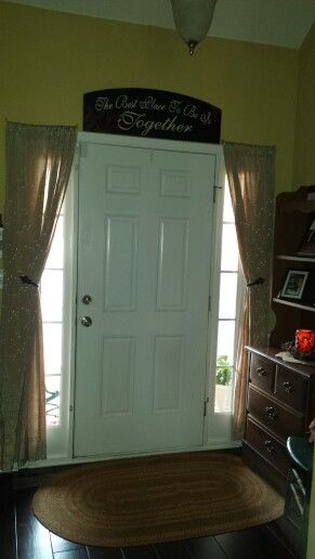 Found this idea, did it & love it. Tie backs for sidelight curtains ;)
