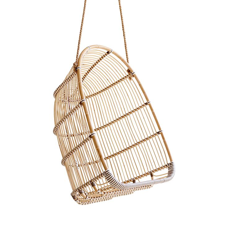 You're never going to want to leave the comfortable confines of this charming Casarano Outdoor Hanging Chair. Made from rattan, this pod-style seat offers a cozy cocoon—perfect for  resting from a fast...  Find the Casarano Outdoor Hanging Chair, as seen in the Naturally Mid-Century Collection at http://dotandbo.com/collections/naturally-mid-century?utm_source=pinterest&utm_medium=organic&db_sku=112805