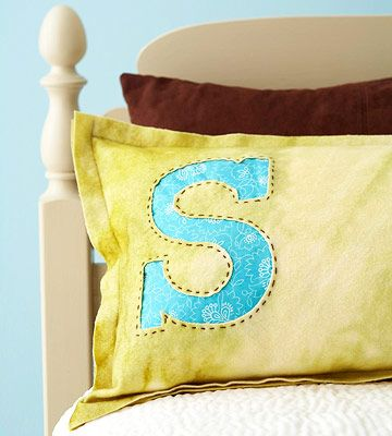 These monogrammed, wool felt pillows can go home with house guests after their holiday visit!