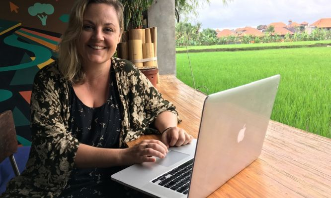Jobs we love: location independent #lecturer    Janet Keating is sitting at her #laptop, marking #student essays. Nearby, a friend is having a nap in a hammock, while a monkey tries to steal someone's lunch.