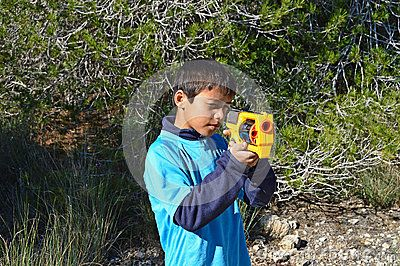 A child holding and aiming A toy Nerf gun