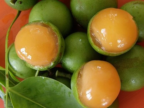 Canepas, the most amazing Carribean fruit... it breaks open & looks like an egg yolk but Tobago ones are nice & sweet