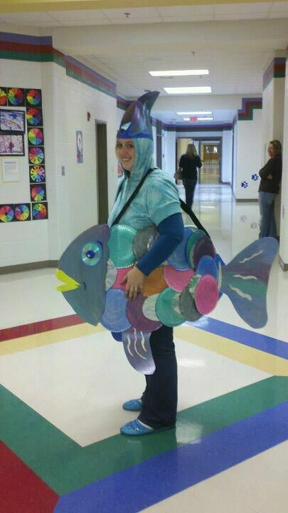 Rainbow Fish DIY Book Character Day Costume made from posterboard, old CDs and bottlecaps, paper plates, and lots of paint and glitter, staples and tape!