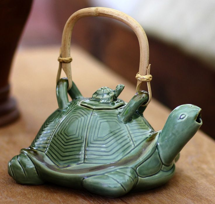 Features: -Material: Ceramic, rattan handle. -Mother Sea Turtle. -Dishwasher: use top rack only, hand wash recommended. -Free of lead and toxins. -Microwave safe. --A mother turtle swims across