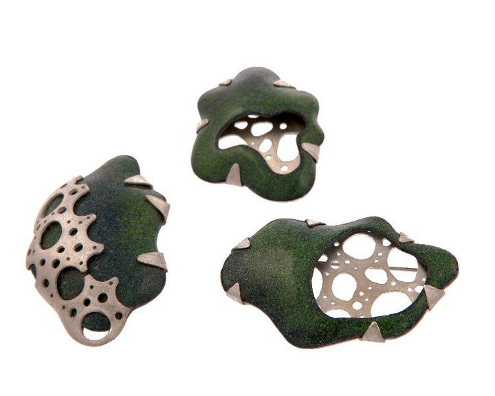 hydraulic pressed copper, enamel and saw pierced sterling silver brooches based on drawings of plant cross sections.