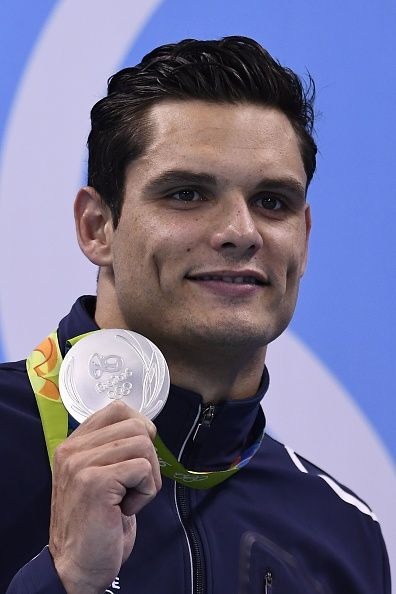 #RIO2016 France's Florent Manaudou poses with his silver medal on the podium of the Men's 50m Freestyle Final during the swimming event at the Rio 2016...