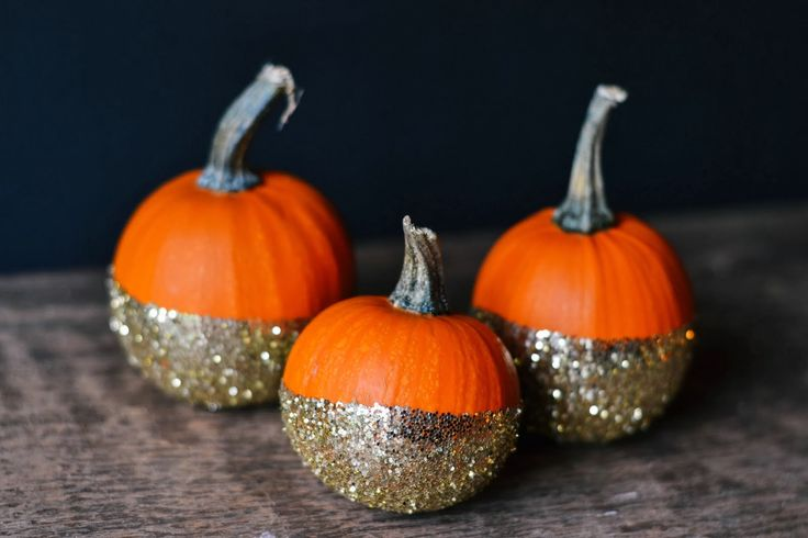 DIY dip-dye glitter pumpkins. Great for fall decorations for the house or even for a party.