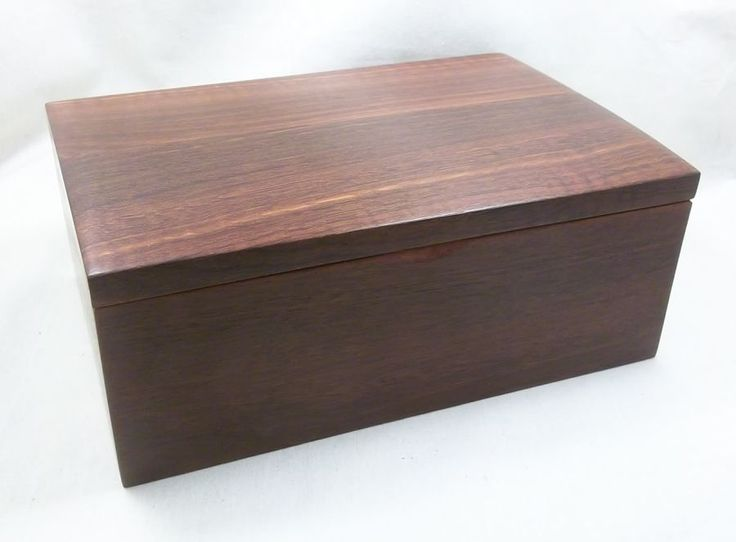Jarrah jewellery box with nicely figured timber in the lid which is shaped slightly to provide for a dome shape.
